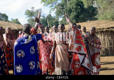 Lolgorian, Kenya. Siria Maasai Manyatta; group of women with typical beadwork adornments, earrings and bracelets. - Stock Photo