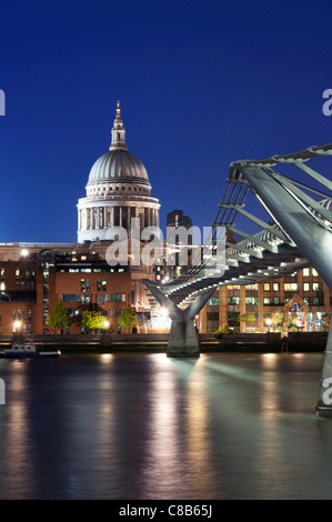 Early evening view of St Paul's Cathedral overlooking the River Thames - Stock Photo