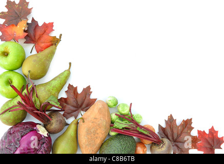 Border made of autumn leaves, and seasonal fruits and vegetables - Stock Photo