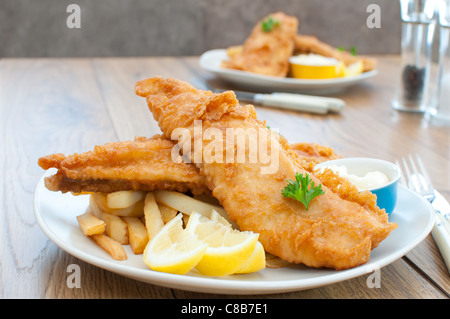 Traditional plate of fish and chips - Stock Photo
