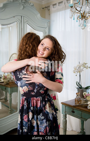 Happy siblings hugging each other - Stock Photo