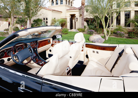 Close-up view of luxury car interior with white leather seats - Stock Photo