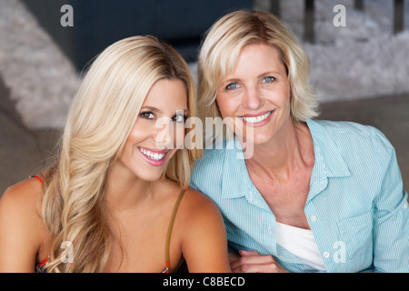 Close-up portrait of mother and daughter - Stock Photo