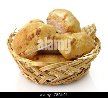 Freshly baked bread rolls in a basket on white background - Stock Photo