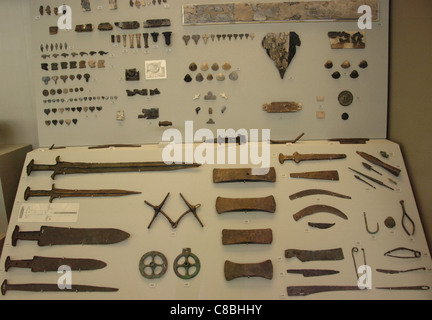 Prehistoric Art. Age of Metals. Greece. Different types of knives, axes and various utensils. - Stock Photo