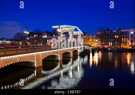 The Magere Brug at night, River Amstel, Amsterdam, Netherlands - Stock Photo