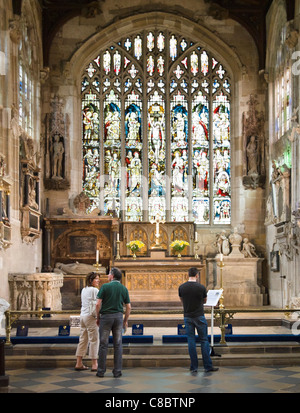 Visitors looking at grave of William Shakespeare in chancel of Church of Holy Trinity, Stratford-upon-Avon, Warwickshire, - Stock Photo