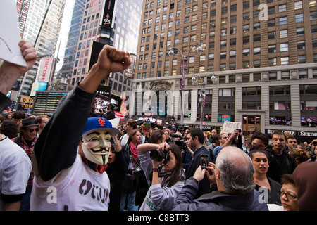 Man wearing Guy Fawkes mask at an Occupy Wall Street Protest march in Times Square, New York City.  October 15, - Stock Photo