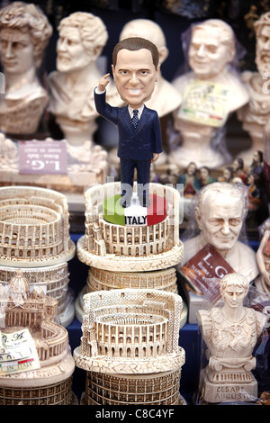 A figurine of Italian Prime Minister Silvio Berlusconi on sale with other souvenirs in Rome, Italy. - Stock Photo