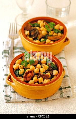 Chickpeas with spinach and mushrooms. Recipe available. - Stock Photo