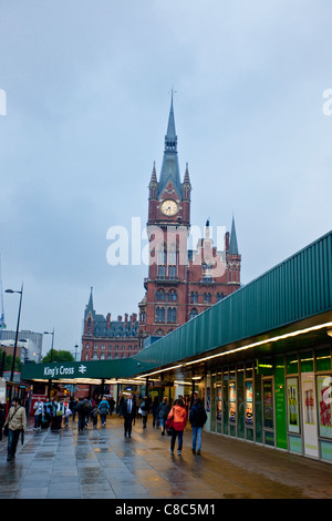 King's Cross Railway Station on a rainy afternoon, with St Pancras Station on the background, London, England, UK - Stock Photo