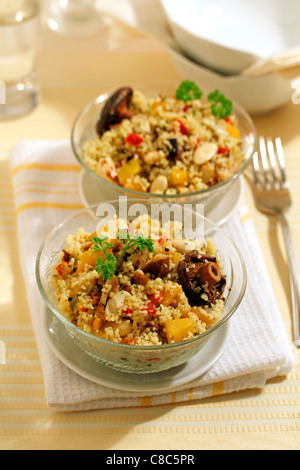 Couscous with mushrooms. Recipe available. - Stock Photo
