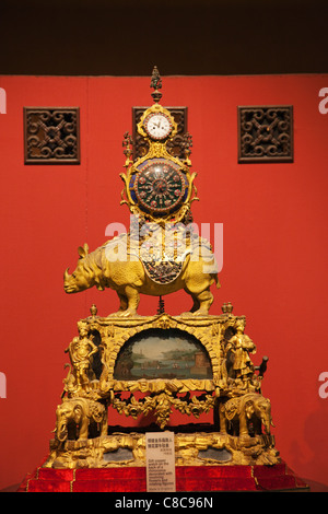 China, Beijing, Palace Museum or Forbidden City, The Clock Museum, Gilt Copper Clock on the back of a Rhinoceros - Stock Photo