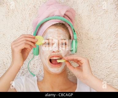 Teenage girl wearing beauty mask - Stock Photo