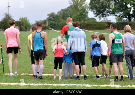 People on start line of a family fun run - Stock Photo