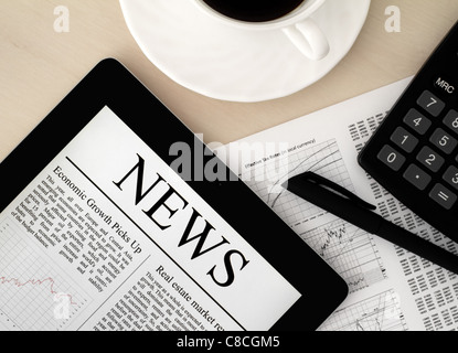 Desktop with a Tablet PC, which shows the latest news on screen. - Stock Photo