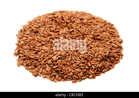 Brown flax seeds on a white background - Stock Photo