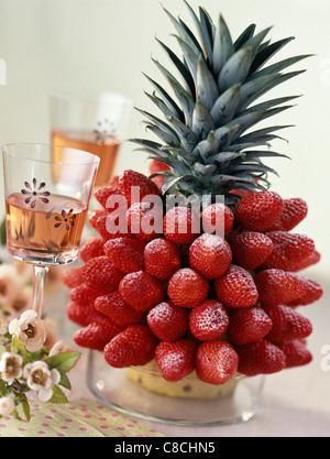 Pinapple decorated with strawberries - Stock Photo