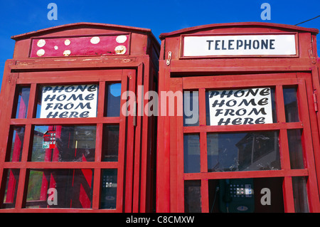 Homemade telephone box, to mimic the old styled British telephone kiosk, on the beach at Sidari, Corfu, Greece - Stock Photo