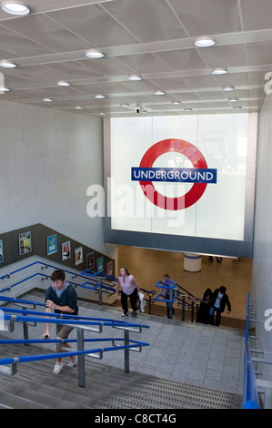 Passengers climbing stairs from a London Underground station, England. - Stock Photo