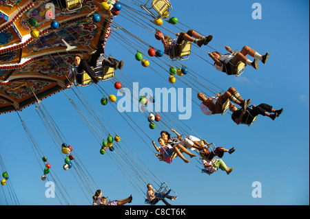 world famous Oktoberfest in Munich, Germany, with carousel - Stock Photo