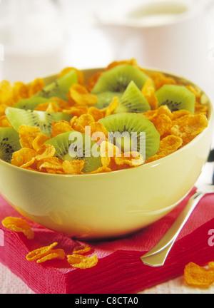bowl of cornflakes and kiwi - Stock Photo