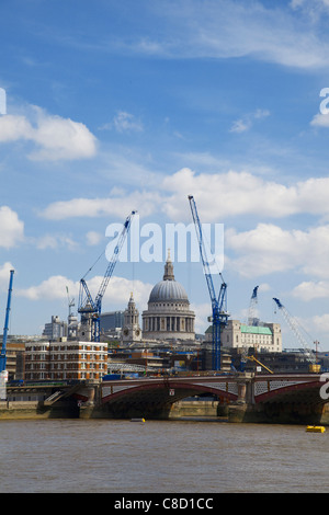 St Pauls Cathedral dome framed by modern cranes, London - Stock Photo