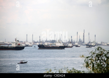 Container vessels near the Port of Singapore, South China Sea. - Stock Photo