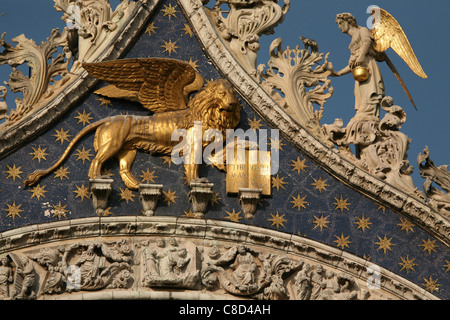 Lion of Saint Mark above the main gate of Saint Mark's Basilica on Piazza San Marco in Venice, Italy.