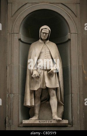 Statue of Renaissance painter Giotto at the main facade of The Uffizi Gallery in Florence, Italy. - Stock Photo