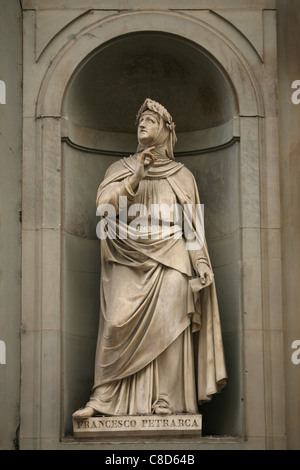 Statue of Renaissance poet Francesco Petrarca at the main facade of The Uffizi Gallery in Florence, Italy. - Stock Photo