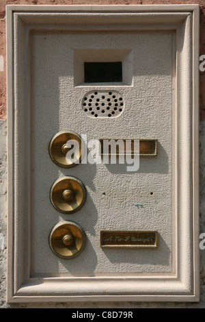Traditional doorbells in Venice, Italy - Stock Photo