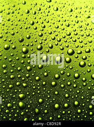 Texture of water drops on the bottle of beer. - Stock Photo