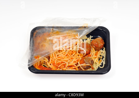 Tray of microwave spaghetti and meatballs with plastic cover still on & pulled open fresh out of cooking in microwave - Stock Photo