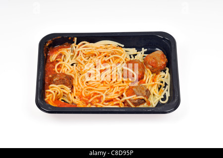 Tray of microwave cooked spaghetti and meatballs readymeal on white background, cutout. - Stock Photo