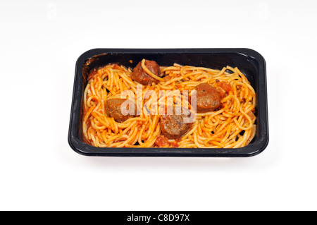 Tray of cooked microwave spaghetti and meatballs readymeal on white background, cutout. - Stock Photo