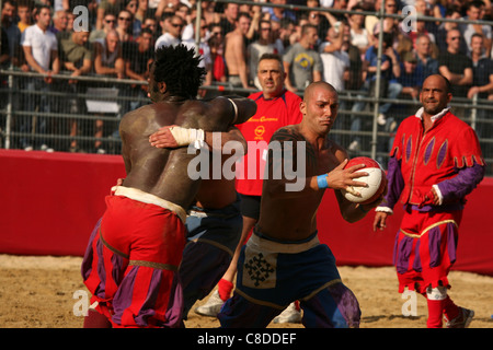 Calcio Storico Fiorentino. Final match in historical football at Piazza di Santa Croce in Florence, Italy. - Stock Photo