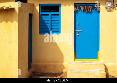 Colourful Blue and yellow rural Indian village house. Andhra Pradesh. India