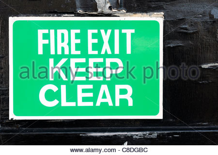 Fire Exit Sign, Blandford Forum, Dorset England - Stock Photo