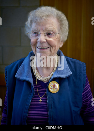 90 year old woman on her birthday and wearing an appropriate lapel badge. England UK Europe nonagenarian people - Stock Photo