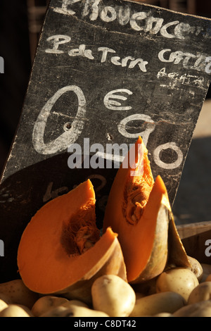 Vegetable market stall with price written on a blackboard - Stock Photo