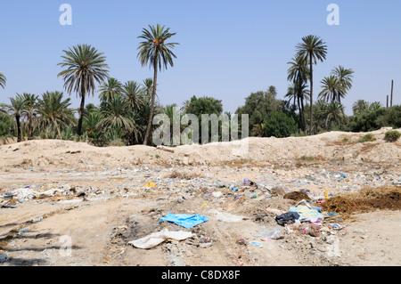 Rubbish Dump on the edge of The Palmeraie, Tiznit, Souss-Massa-Draa Region, Morocco - Stock Photo