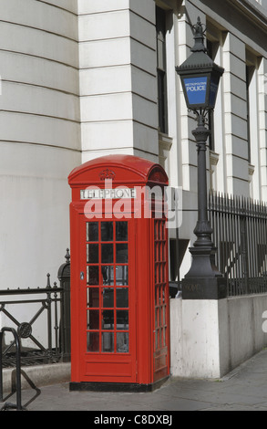 A classic London combination- the red telephone box and the old Metropolitan Police blue light. The Strand, Central - Stock Photo