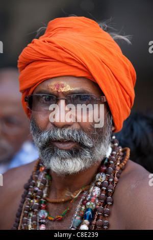 Hindu sadhu pilgrim with beads and turban in holy city of Varanasi, Benares, India - Stock Photo