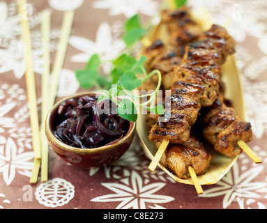 Satay-style pork kebabs grilled on the barbecue - Stock Photo