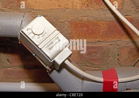 Frost thermostat on pipework in an outside boiler house. The Stock ...