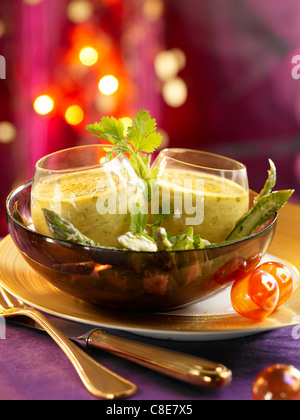 Crab and curry Flan with asparagus salad - Stock Photo