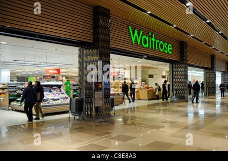 Waitrose food supermarket store front grocery shopping mall access within Westfield shopping centre at Stratford - Stock Photo
