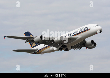 Singapore Airlines Airbus A380 long haul passenger jet plane on takeoff from London Heathrow Airport - Stock Photo