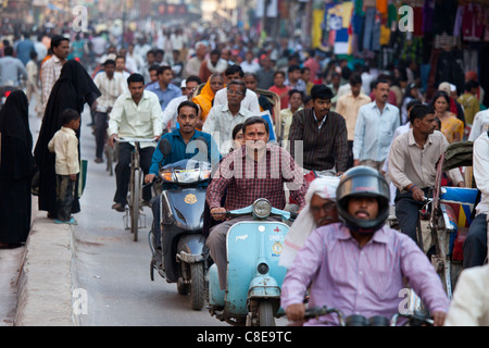 Crowded street scene during holy Festival of Shivaratri in city of Varanasi, Benares, Northern India - Stock Photo